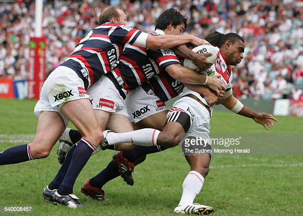 The Dragons' Wes Naiqama is tackled by three Roosters during the NRL Round 7 match between the Sydney Roosters and St George Illawarra Dragons at...