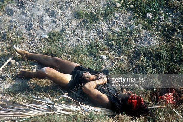 The dramatic picture showing the body of a man on the ground with his skull reduced to a pulp after an explosion Ku Chi 1968