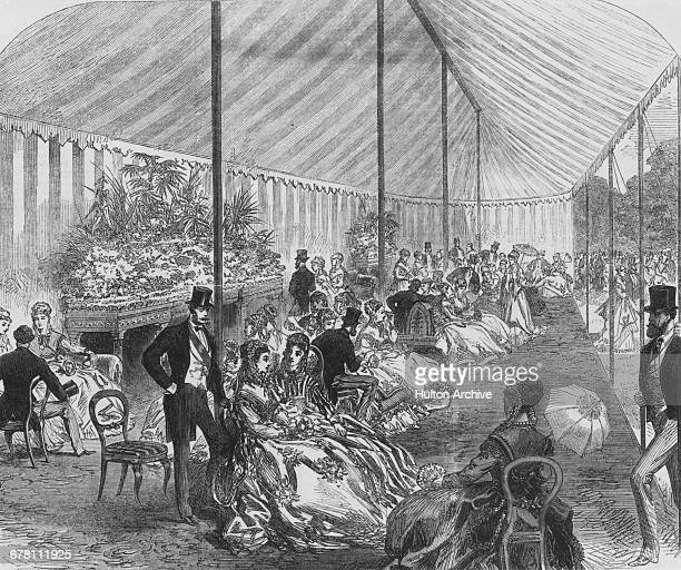 The drawing room tent at the Queen's Garden Party hosted by Queen Victoria in the grounds of Buckingham Palace London June 1868 An engraving by A...