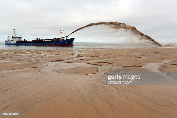 The dredger 'Cotes de Bretagne' shoots sand onto a beach of PylasurMer in La TestedeBuch in Arcachon Bay The boat from Brittany pumps sand from...