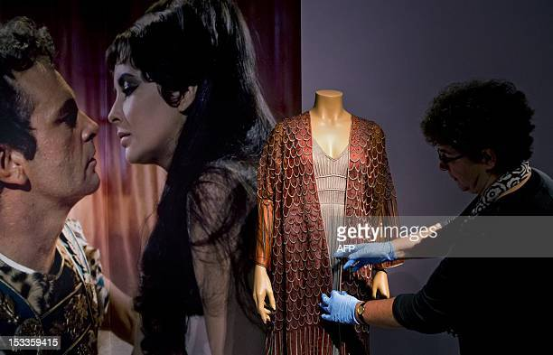 The dress British actress Liz Taylor wore in the 1963 movie 'Cleopatra' is readied on October 4 2012 for the exhibition 'Hollywood's Egypt' at the...