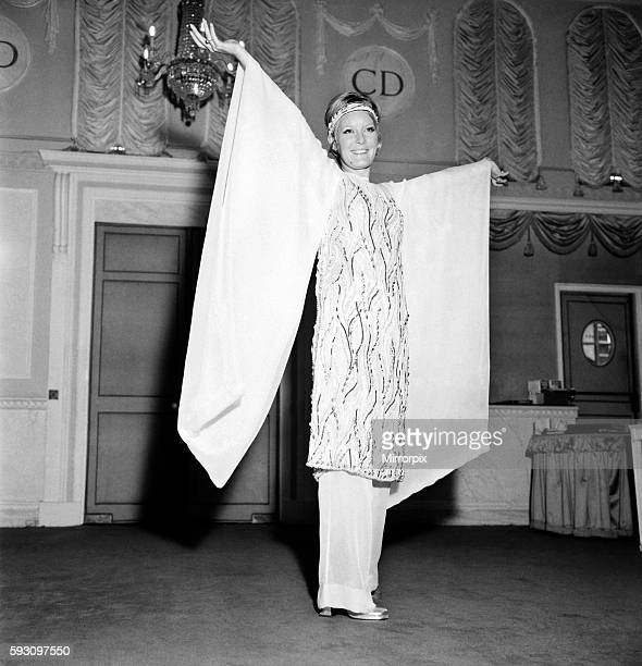 The dress is a dream of white chiffon embroidered all over with pearls, silver beads, silver thread, a tunic over chiffon trousers. November 1969...