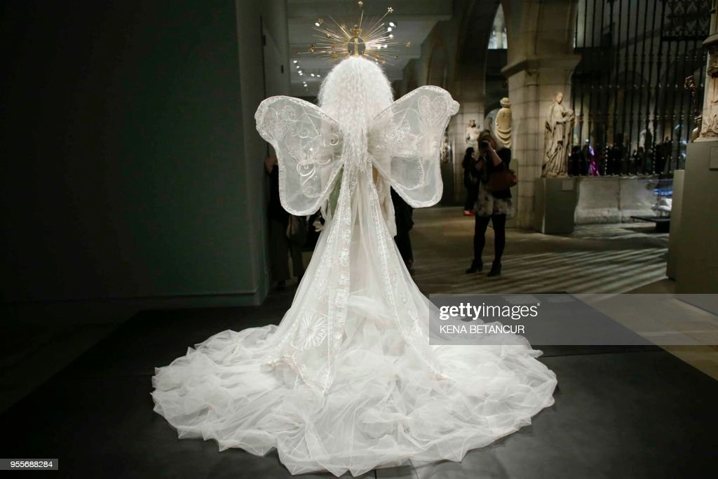 The Dress 'Madonna' wedding ensemble by House of Dior is seen during the Press Preview for the annual fashion exhibition 'Heavenly Bodies: Fashion and the Catholic Imagination' at The Metropolitan Museum of art on May 7, 2018 in New York.