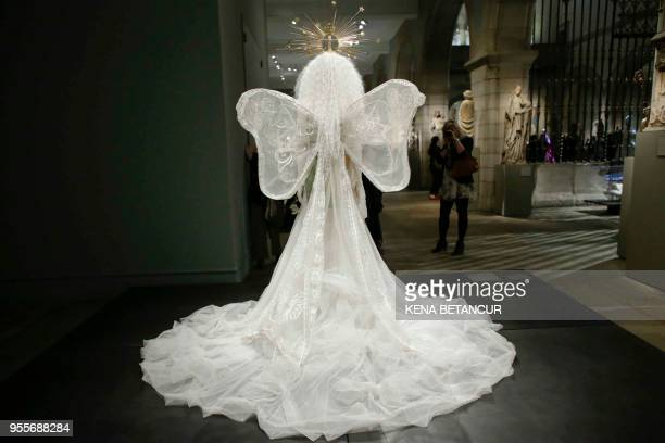 "The Dress ""Madonna"" wedding ensemble by House of Dior is seen during the Press Preview for the annual fashion exhibition ""Heavenly Bodies: Fashion..."