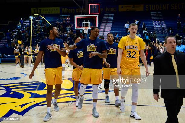 The Drexel Dragons celebrate their win over the Delaware Fightin Blue Hens after the game at the Daskalakis Athletic Center on February 22 2018 in...