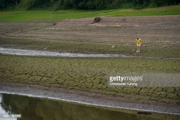 The dried up bed of Wayoh Reservoir near Bolton as the heatwave continues across the UK on July 23 2018 in Bolton England A hosepipe ban in the North...