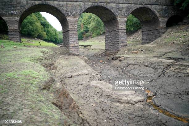 The dried up bed of Yarrow Reservoir near Bolton as the heatwave continues across the UK on July 23 2018 in Bolton England A hosepipe ban in the...