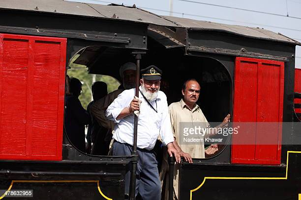 The driver and his assistant in the engine's cabin. Few years before The Last steam safari was arranged from Lahore Cant Station to Changa Manga...