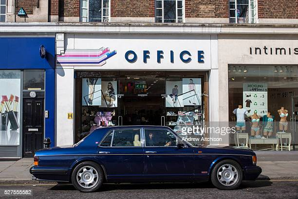 The driver of a Bentley car checks for traffic before pulling away