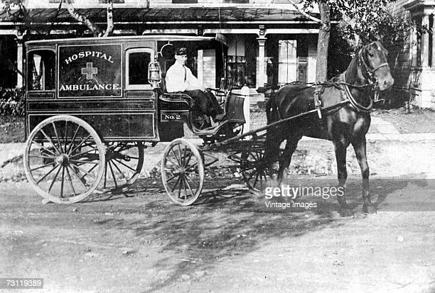 The driver of a horsedrawn ambulance poses with his rig late 1800s or early 1900s