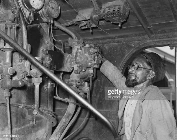 The driver of a special train leaving New Delhi Station to relocate six hundred Muslim residents of Delhi to Pakistan following the partition of...