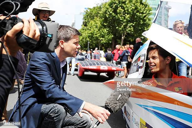 The driver of Nuon Solar Team, Challenger Class from the Netherlands is interviewed during the 2013 World Solar Challenge street parade on October...