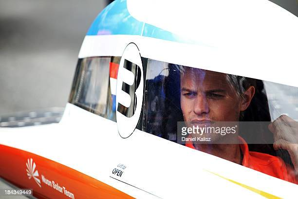 The driver of Nuon Solar Team of Delft University of Technology, Challenger Class from the Netherlands prepares to take part in the 2013 World Solar...