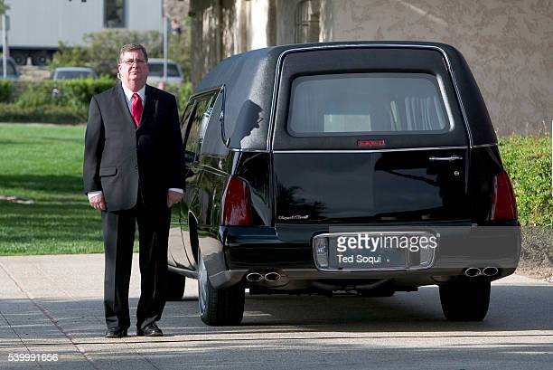 The driver of the hearse waits for the arrival of former President Ronald Reagan's flagdraped casket to transport it to the Point Mugu Naval Air...