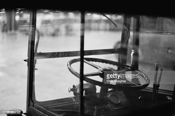 The driver's cab and steering wheel of a Leyland Titan doubledecker bus at Stockwell Bus Garage south London 26th February 1967
