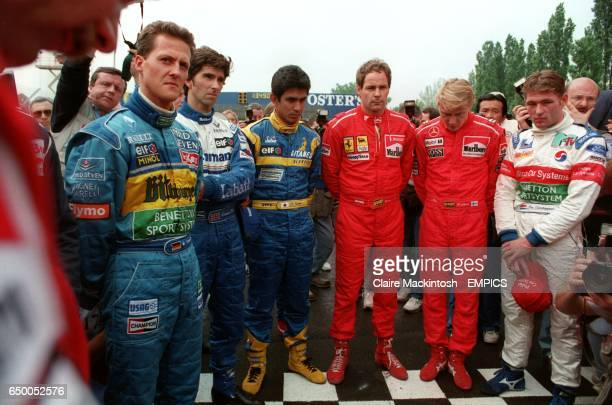The drivers hold a minutes silence for Simtek driver, Roland Ratzenberger killed during the qualifying session and Williams' driver Ayrton Senna, who...