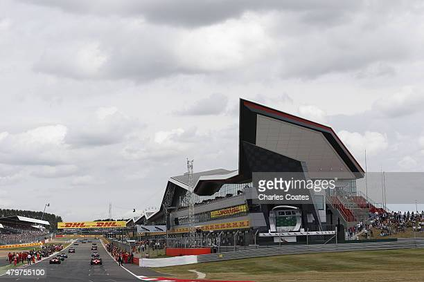 The drivers leave the grid for the parade lap before the Formula One Grand Prix of Great Britain at Silverstone Circuit on July 5, 2015 in...