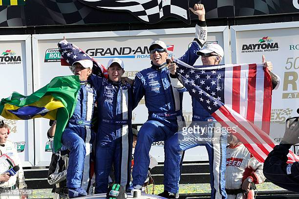 The Drivers of the DP Michael Shank Racing Ford Riley celebrate in Victory lane after winning the Rolex 24 at Daytona International Speedway on...