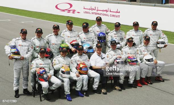 The drivers of the GP Masters series line up for a team photograph after free practice ahead of the Grand Prix Masters race at the Losail...