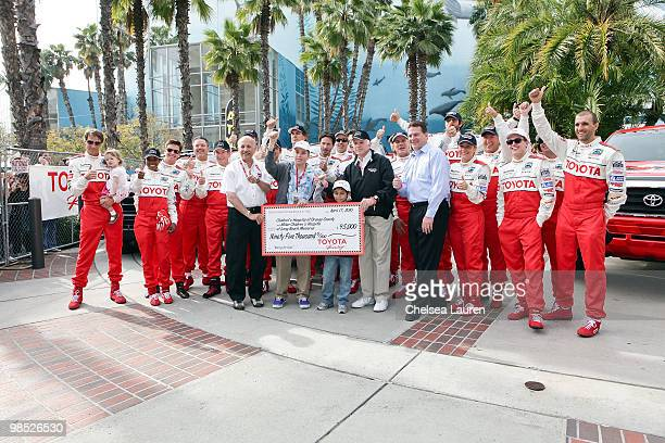 The drivers of the Pro/Celebrity Race gather for a charity check presentation at the Toyota Grand Prix Pro / Celebrity Race Day on April 17 2010 in...