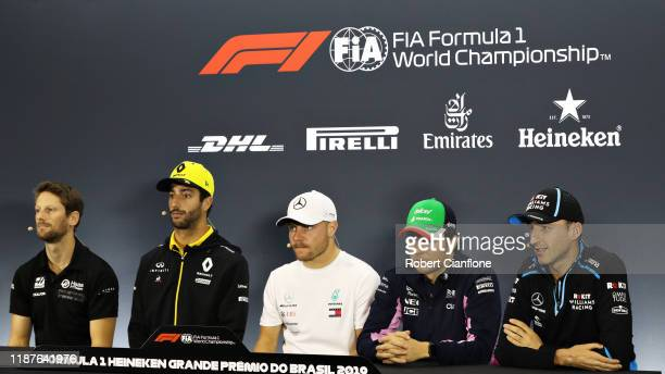 The Drivers Press Conference with Romain Grosjean of France and Haas F1 Daniel Ricciardo of Australia and Renault Sport F1 Valtteri Bottas of Finland...
