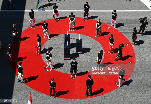 The drivers stand for a minutes silence for the victims of COVID-19 on the grid before during the Formula One Grand Prix of Austria at Red Bull Ring...