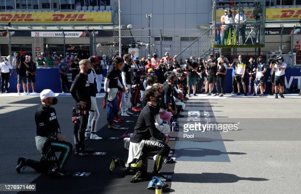 The drivers stand in support of ending racism before the F1 Grand Prix of Russia at Sochi Autodrom on September 27 2020 in Sochi Russia