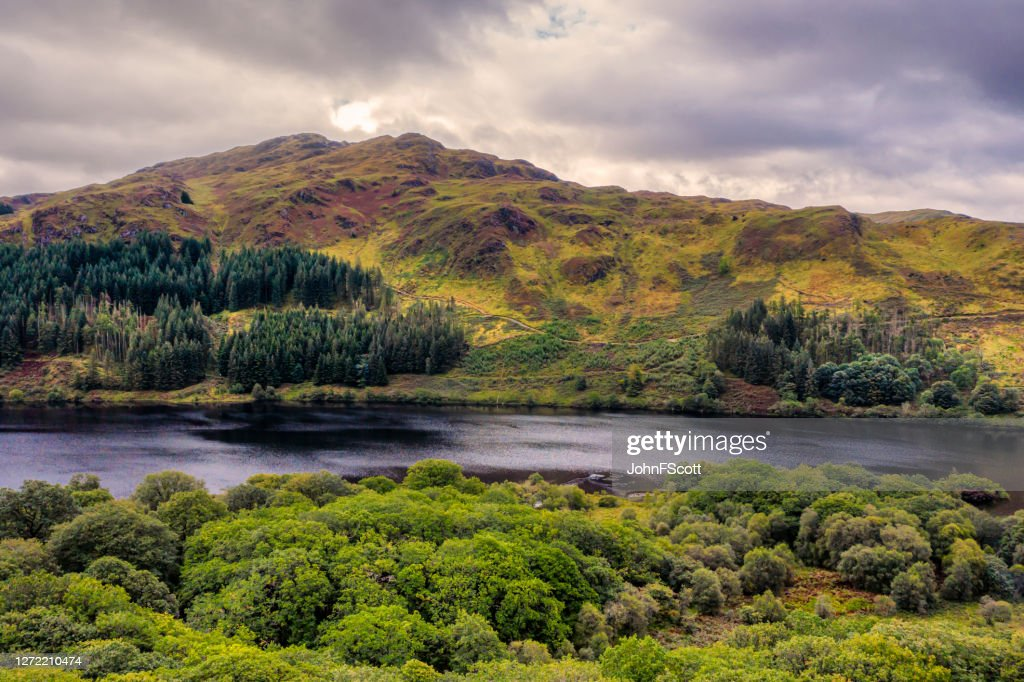 The drone view of a Scottish loch in Dumfries and Galloway on an overcast day : Stock Photo