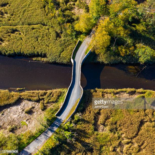 the drone view of an old stone bridge in dumfries and galloway south west scotland - johnfscott stock pictures, royalty-free photos & images
