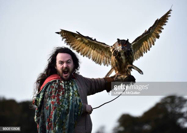 The druid Malachy played by Ciaron Davies interacts with 'Cracker' a european eagle owl as the reenactment of Saint Patrick's first landing in...