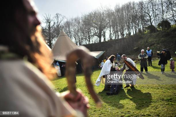 The druid Malachy played by Ciaron Davies is led away from Saint Patrick as the reenactment of Saint Patrick's first landing in Ireland takes place...