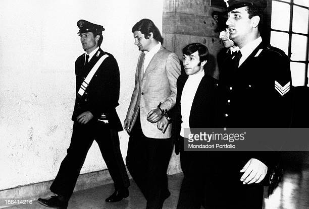The drummer of the Italian music band Equipe 84 Alfio Cantarella was found with 6 hg of hashish he is now led with handcuffs by policemen together...