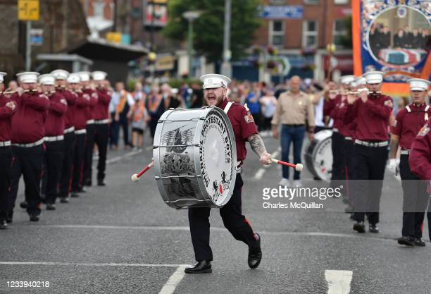 The drummer with the Shankill Protestant Boys Flute band can be seen as the annual Twelfth of July march takes place on July 12, 2021 in Belfast,...