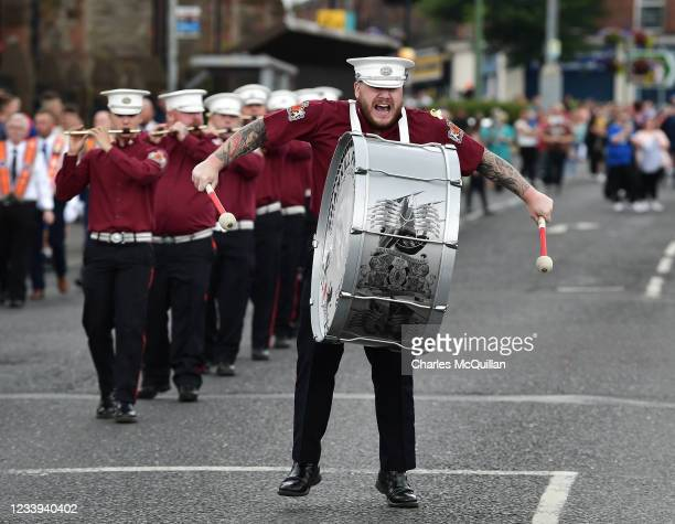 The drummer with the Shankill Protestant Flute band can be seen as the annual Twelfth of July march takes place on July 12, 2021 in Belfast, Northern...