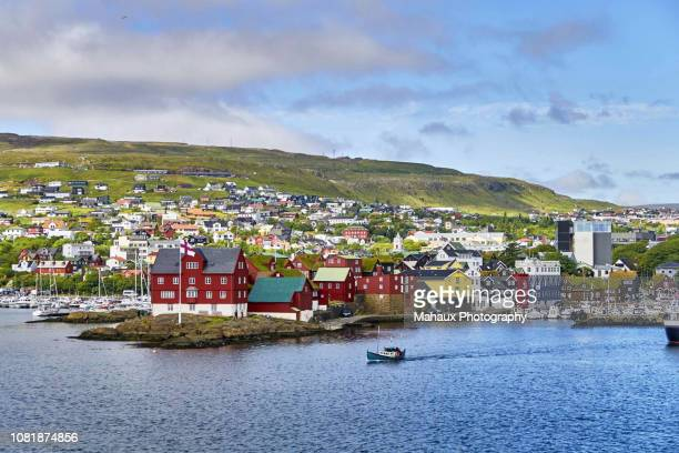 the dual harbor of torshavn around tinganes peninsula, the historical core of the country's capital. - torshavn stock pictures, royalty-free photos & images