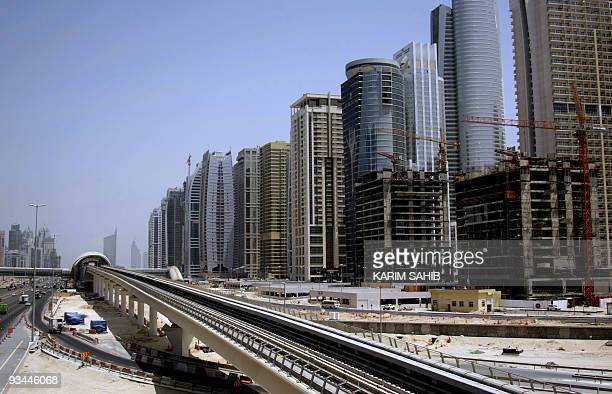 The Dubai metro track is seen along Dubai's Shiekh Zayed road on September 09 as the Gulf emirate prepares to open its new metro network in a bid to...