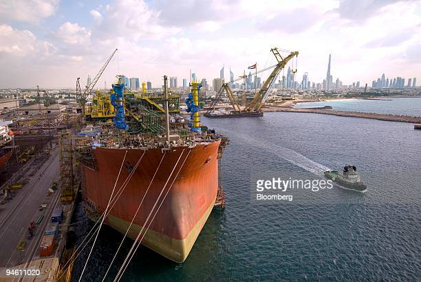 Dubai drydocks world stock photos and pictures getty images the dubai skyline stands behind an oil tanker being converted into a floating production storage offloading gumiabroncs Gallery