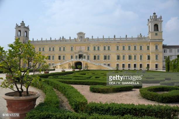 The Ducal Palace of Colorno, designed by the architect Ferdinando Galli Bibiena , seen from the parterre of the French formal garden, Emilia-Romagna,...