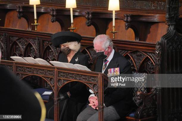 The Duchess and Duke of Cornwall attend the funeral of Prince Philip, Duke of Edinburgh, at St George's Chapel at Windsor Castle on April 17, 2021 in...
