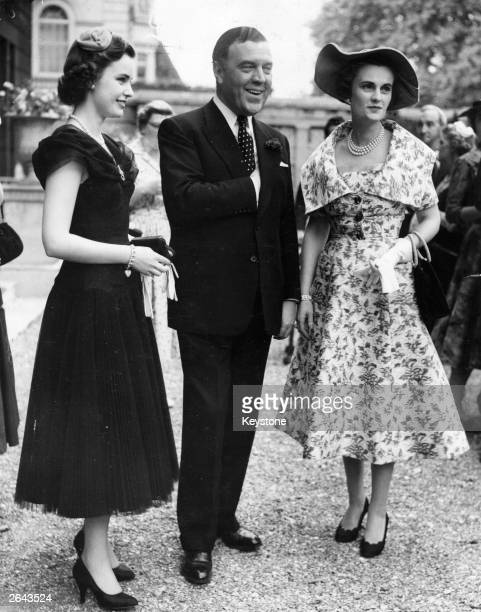 The Duchess of Argyll and her daughter Miss Frances Sweeney with fashion designer Norman Hartnell the English couturier and court dressmaker at a...