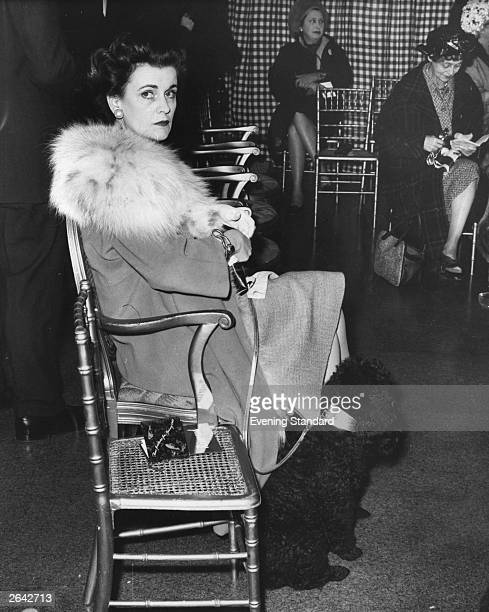 The Duchess of Argyll and her poodle Marcel at a fashion show at Simpson's of Piccadilly