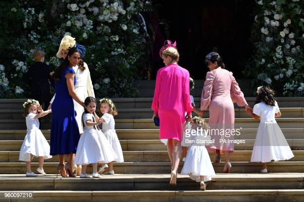 The Duchess of Cambridge and Meghan Markle's friend Canadian fashion stylist Jessica Mulroney holds bridesmaids hands as they arrive for the wedding...