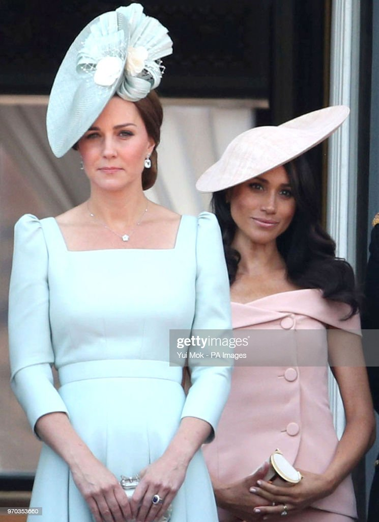 The Duchess of Cambridge (left) and the Duchess of Sussex on the balcony of Buckingham Palace, in central London, following the Trooping the Colour ceremony at Horse Guards Parade as Queen Elizabeth II celebrates her official birthday.