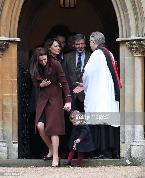 The Duchess of Cambridge Carole and Michael Middleton and Princess Charlotte of Cambridge leave following the service at St Mark's Church on...