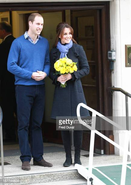 The Duchess of Cambridge Catherine Middleton and Prince William Duke of Cambridge leave the King Edward VII hospital where she has been treated for...