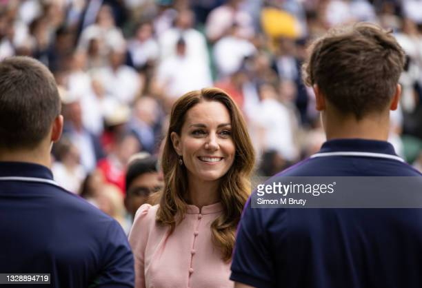 The Duchess of Cambridge chats with ball boys at the Men's trophy ceremony after the Singles Final at The Wimbledon Lawn Tennis Championship at the...