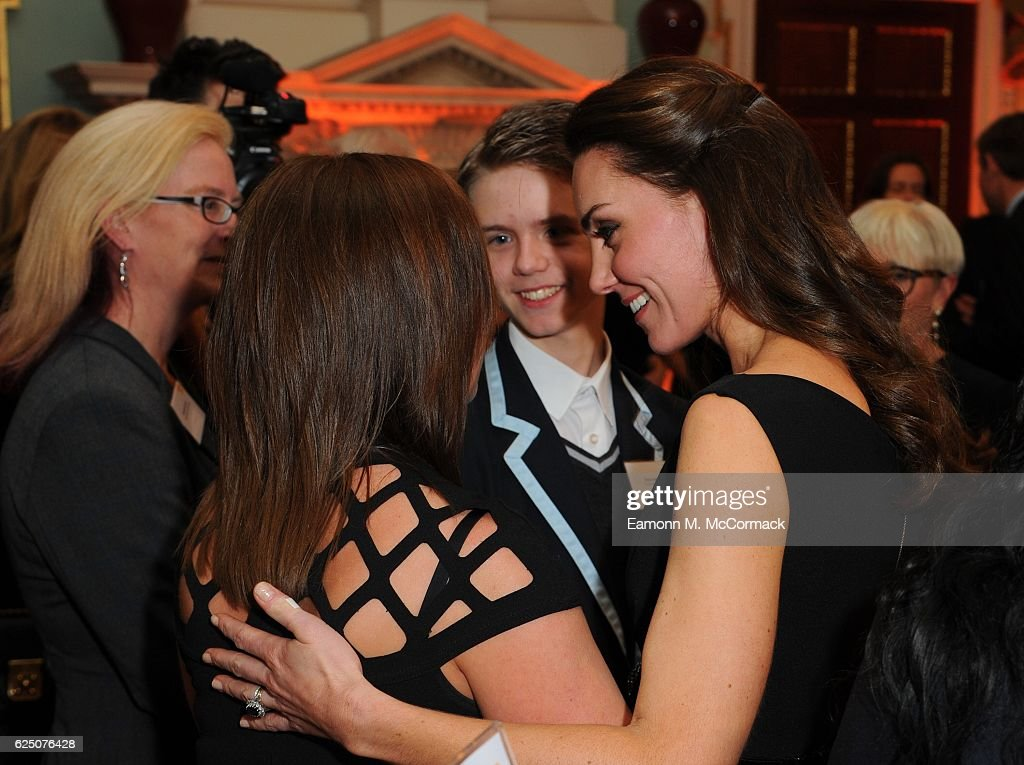 The Duchess of Cambridge comforts Ceri Knapton who joins her son Ethan Knapton from Forward Academy at the Place2Be Wellbeing in Schools Awards at Mansion House on November 22, 2016 in London, United Kingdom.