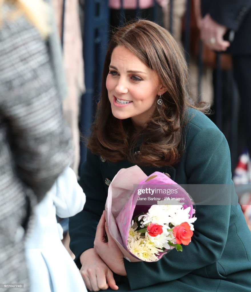 The Duchess of Cambridge holds flowers she was given as she arrived for a visit to the Fire Station arts centre in Sunderland.