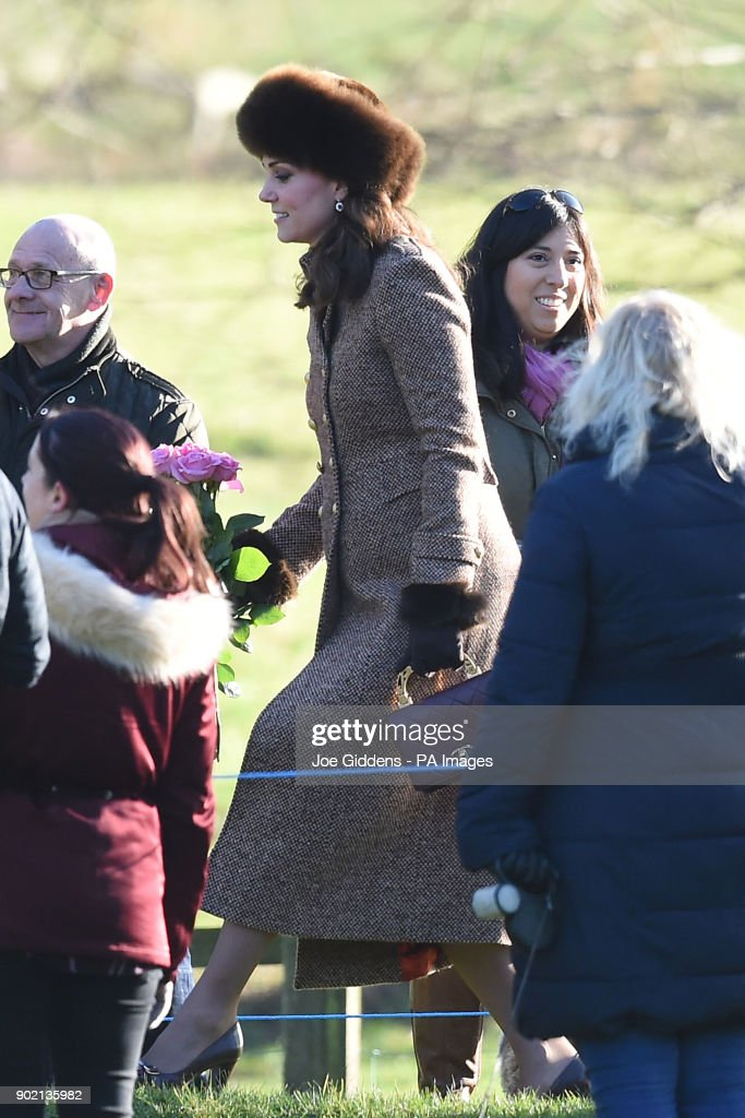 The Duchess of Cambridge holds roses from a child as she attends a church service at St Mary Magdalene Church in Sandringham, Norfolk.