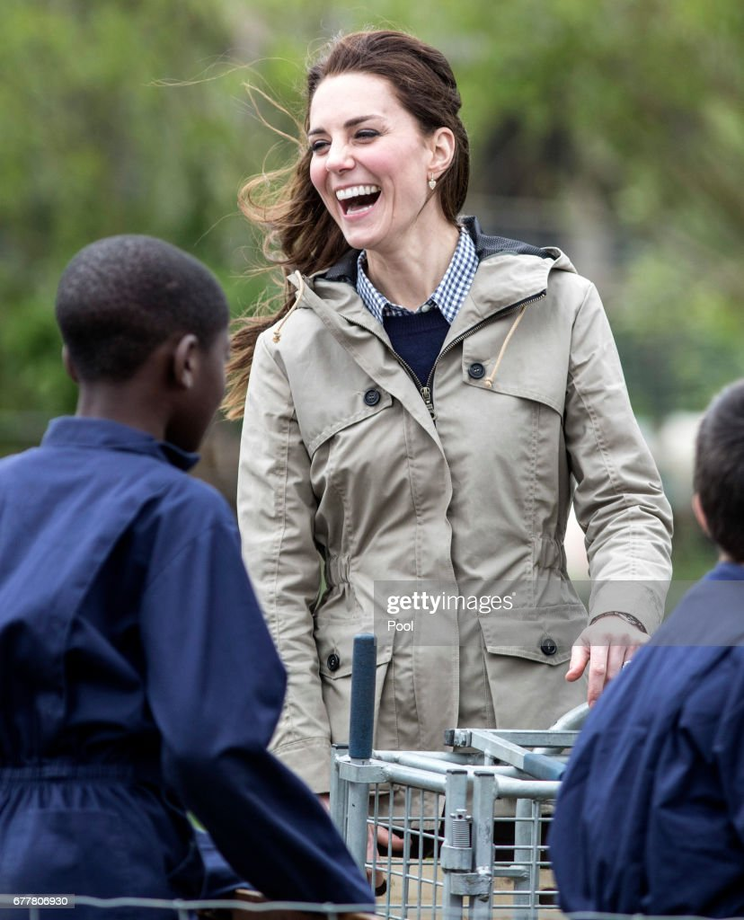 The Duchess of Cambridge jokes with children from Vauxhall primary school in London following their attempt to herd a pig into a pen to be weighed during a visit to a 'Farms for Children' farm on May 3, 2017 in Arlingham, Gloucestershire. The Duchess of Cambridge visited Farms for City Children to see their work giving young people from inner cities the chance to spend a week on a real working farm. Her Royal Highness joined a school group of pupils and teachers as they mucked in around the farm, and met childrens author Michael Morpurgo and his wife Clare to learn more about the organisation they founded in 1976. The charity offers urban children from all over the country a unique opportunity to live and work together for a week at a time on a real farm in the heart of the countryside. It is an intense, learning through doing experience of a different life for children who may not know where their food comes from and have limited opportunities to explore the outside world. The organisation now has three working farms, where it welcomes around 3,200 children and 400 teachers a year.